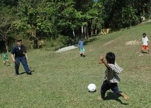 Playing soccer with children at Aeta Resettlement, Philippines. (Courtesy Michael Gomez, US Navy, wikimedia commons)